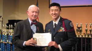 Vice President Holmes presenting the medal to Cadet Major Yeh